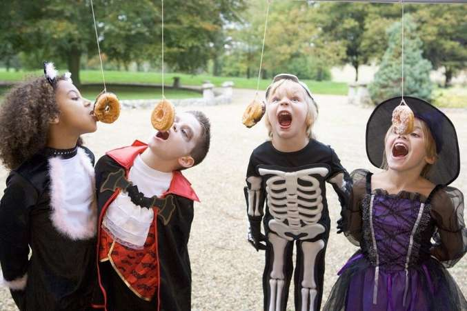 eating doughnuts on a string halloween game