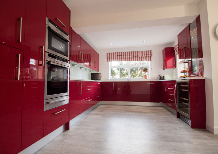 Red gloss kitchen in Southwater