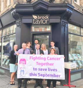 brcok taylor team with banner
